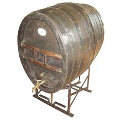 19th Century Large French Oval Wine Barrel on Adjustable Stand | From a unique collection of antique and modern more antique and vintage finds at https://www.1stdibs.com/furniture/more-furniture-collectibles/more-antique-vintage-finds/