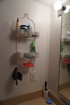 DIY SMALL BATHROOM SHELVES-  use a shower caddy as storage cheap and easy