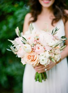 The bridesmaids will carry clutch bouquets of peachy garden roses, cream hydrangeas, blush stock flowers, white ranunculus, blush spray roses, olive branches, and jasmine vine wrapped in ribbon (color TBD) with the stems showing.