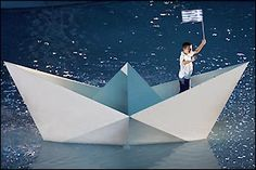 Athens 2004 Olympic Games - The focus of the crowd falls onto a small Greek boy