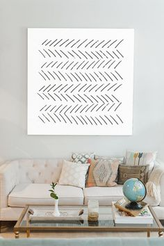 Turn your living room into a serene living scape with art that feels as light as a feather. Interior design inspiration.