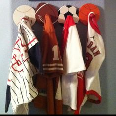 My boys room with sports theme - I used their jerseys as wall decor