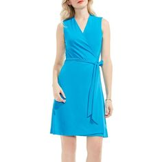 Women's Vince Camuto Wrap Dress ($59) ❤ liked on Polyvore featuring dresses, havana blue, vince camuto dresses, no sleeve dress, jersey dress, blue jersey dress and jersey wrap dress