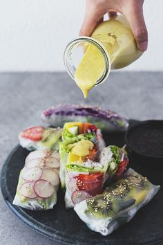 Rainbow Spring Rolls with Mango, Basil & Lime Tahini Cream + Ginger & Sesame Soy…