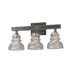 The Menlo Park 3-light Bath Sconce comes in an old silver finish and a clear shade.  This fixture is made of hand-worked iron, stainless steel, solid brass, and historic pressed glass material.
