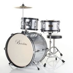 Barcelona Three-Piece 16-Inch DRM316 Kid's Drum Set with Cymbal, Seat and Sticks - Silver by Barcelona. $99.95. Fun and cute at the same time, Barcelona's three-piece kid's drum set is the perfect size for children between the ages of three and five years old. The drum set comes packaged with everything your child needs to get rockin' right away -- a drum throne, bass drum pedal, crash cymbal, and pair of sticks. Manufactured with an emphasis on durability, it's made to w...