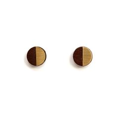 Turpentine Josephine Walnut & Brushed Brass Earrings: These little Josephine Walnut & Brushed Brass Earrings are part of a brand new mixed material jewellery collection designed in-house by Jude de Berker and exclusive to the Turpentine.  Inspired by time spent in her dad's carpentry workshop as a child and her training as a jeweller at Central Saint Martins the range mixes solid walnut wood with brushed steel, copper, brass and 100% solid silver earrings backs and findings.  The design…