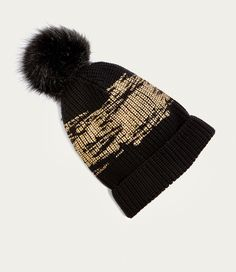 1b3f46bcf01 The answer s simple  a soft black glittery knitted hat with a statement fur  faux bobble.