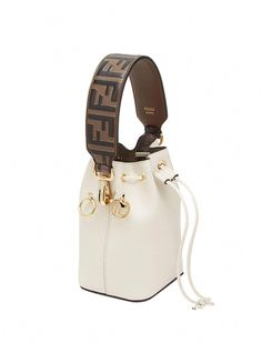 Fendi mini Strap You bag strap - Brown #mini #fendi #bag #minifendibag Fendi's leather pieces are an ode to elegance and beauty. By combining supreme femininity with a playful twist, the brand has been able to create breathtaking designs that last a lifetime. Crafted from leather, this bag strap features gold-tone hardware, a lobster clasp closure and the label's signature FF motif. Luxury Purses, Luxury Bags, Luxury Handbags, Fashion Handbags, Fashion Bags, Designer Handbags, Designer Purses, Fashion Fashion, Designer Shoes