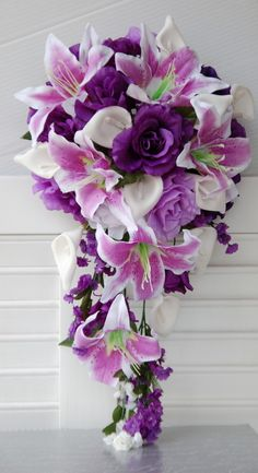 Purple and Lavender Rose, Tiger Lily, and Calla lily cascade wedding bouquet. my dream bouquet ! Bouquet En Cascade, Cascading Wedding Bouquets, Purple Wedding Flowers, Bride Bouquets, Bridal Flowers, Wedding Colors, Lily Wedding, Purple Bouquets, Wedding Boquette