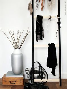 via Apartment Therapy: Livet Hemma painted the vertical bars black, left the horizontal slats unfinished, leaned the unit against a wall, et voilà — instant accessories rack! A basic stand becomes a chic display for scarves, belts, bags, and a host of other fashion accessories.
