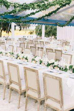 Dinner tables, upholstered chairs, leaf garland by Tara Guerard Soiree taraguerardsoiree.com   Photography- Corbin Gurkin corbingurkin.com #charlestonplantationwedding #navyandwhitewedding #taraguerarddecor