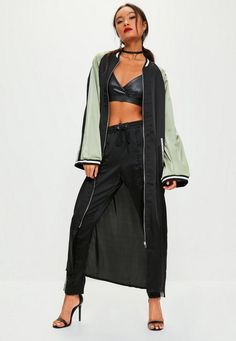 sporty attire meets street style, get some new wearing this black bomber jacket - featuring contrasting khaki sleeve details, a striped lapel and longline style.