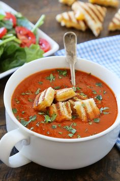 Tomato-Basil Soup with Grilled Cheese Croutons - Easy, healthy and hearty! Top with crispy, gooey grilled cheese croutons and serve with a green salad. thecomfortofcooking.com @redgoldtomatoes #helpcrushhunger