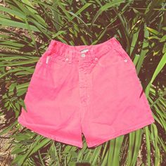 "High Waist Coral Denim ""Mom"" Shorts Size 3,4,5 If only I could wear these. :( Such a cute trend with a crop top and vans. Can cut and fray them or leave them as is. Love these vintage Bongo brand (so big in the '90s), deep coral/melon/salmon denim shorts--get bright in the sun. Has a characteristic bleach spot (shown) on right upper side.  Zip fly, with sturdy button closure.  5-pocket styling.   Flat measurements: • Waist: (12"" above inseam) 12.5"" • Hip: (7"" below waist) 17"" • Leg opening…"