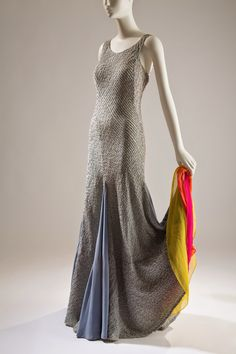 *  Elsa Schiaparelli.  Light blue evening gown with wired pintucks and interior colored ruffles at flared hem, mid-1930s,