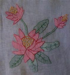 Stitchery, appliqué or wadding showing beneath a translucent fabric.
