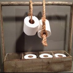 Yes, I just pinned toilet paper. On a cute holder.  I think think rope would splinter on the tp tho, hmm what to hang it with?
