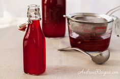How to Make Cranberry Liqueur, with a touch of vanilla bean. Great for hostess gifts.