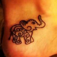 heel elephant tattoo... (placement more than the tattoo)