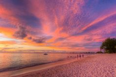 16 Best Beaches in the Caribbean ((A sunset view of Seven Mile Beach in Grand Cayman.))