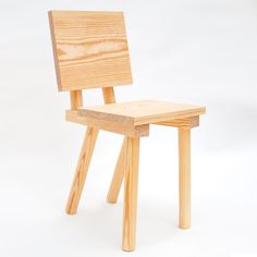 This wooden chair by designers Markus Bergström and Joe Nunn of Glass Hill for Phillips de Pury is on show at the Saatchi Gallery in London. Chunky dowels form legs and support the backrest, and are inserted in two batons supporting the seat. Made of pine, the chair is on show alongside work by Max