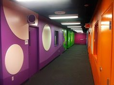 Worlds of Wow - some of our themed church environments are not murals but brightly colored walls with fun geometric  shapes for young children to touch as they walk down the hallway.