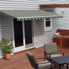 ALEKO 10 ft. W x 8 ft. D Fabric Retractable Standard Patio Awning & Reviews | Wayfair Ely, Roof Overhang, Patio Canopy, Door Canopy, Retractable Awning, Concrete Wood, Protecting Your Home, Outdoor Living