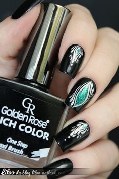 Really pretty amorphous yet symmetrical nail art - metallic silver, black, color pop