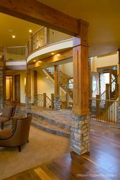 step down into great room with stone/wood column delineation.  Like barrel shaped catwalk above.