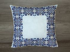 Check out this item in my Etsy shop https://www.etsy.com/listing/518769202/geometric-blue-white-cross-stitch-pillow
