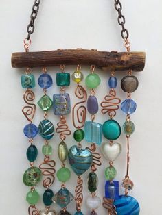 This glass beaded wind chime and sun catcher is the perfect way to brighten your. - This glass beaded wind chime and sun catcher is the perfect way to brighten your patio, yard, a kitc - Wire Crafts, Fun Crafts, Beaded Crafts, Baby Crafts, Mesquite Wood, Diy Wind Chimes, Glass Wind Chimes, Garden Crafts, Wire Art