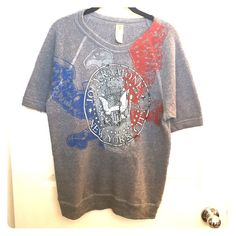 Gray Joey Ramone NYC Sweater T-Shirt - The Ramones Gray Joey Ramone NYC Sweater T-Shirt - The Ramones. Awesome sweater t-Shirt! Has sweater material but is not too warm. Hardly worn! Tops