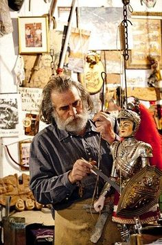 Strings attached: Sicilian puppet-maker puts the finishing touches to a model knight www.dailymail.co.... Follow us: @MailOnline