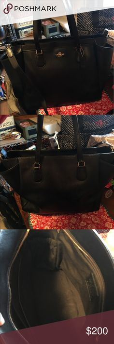 Black coach tote with detachable long strap Black coach tote with detachable long strap. Owned less than a year (most of which it sat in a closet!) no major wear or tear, in great condition! Coach Bags Totes