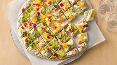 "What do you get when you combine two convenience ingredients with fresh veggies and shredded cheese? The answer: This colorful veggie-topped ""pizza""!"