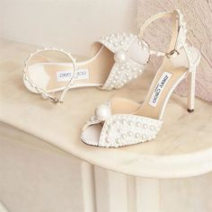 jimmy choo wedding shoes Whether classically all-white, sparkly, or blue-tinted, here are five major fashion players with beautiful bridal shoe collections. Future brides are sure to find a gem here for their special days ahead. Pearl Sandals, Pearl Shoes, Shoes Sandals, Jimmy Choo, Manolo Blahnik, Stilettos, High Heels, Sparkly Wedding Shoes, Wedding Heels