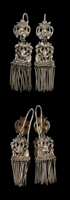 Southern China | Pair of pendants earrings; silver with phoenix and frog motifs. | ca. 19th - 20th century | POR