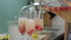 How to Make Champagne Cocktails | Cocktail Recipes. I love the lemon juice and ginger syrup, probably would use a sparkling cider w/o the alcohol. The raspberries look romantic.