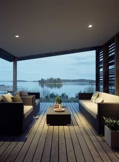 If you live by the lake, creating a custom home with a solid wall of windows will be breathtaking.