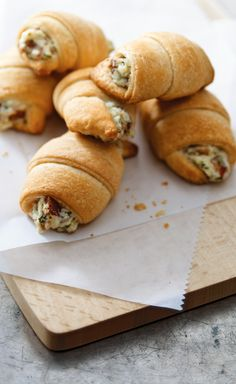 "Bacon Appetizer Crescents – Savory dip meets crescent roll for a whole new take on hot appetizers. These toasty bites will go faster than you can say, ""They have OSCAR Mayer Bacon in them."" Thinking about serving this at your New Year's Eve party? Sprinkle lightly with poppy seed before baking to make them extra special."