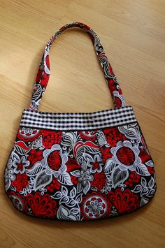 The Marilyn: Black, red and white medium size purse with great detail work. $40.00, via Etsy.