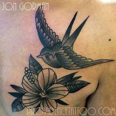 by jon gorman at providence tattoo  #jongorman #providencetattoo #swallow #tattoo #flower #swallowtattoo #blackwork #traditional #old school #hibscus