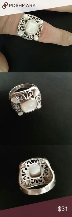 MOP 925 Sterling Silver Ring Gorgeous mother of pearl set in filigree stamped 925 silver. Jewelry Rings