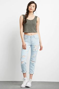 These boyfriend jeans feature a heavily distressed front, a five-pocket construction, a zip fly, and a cuffed hem.