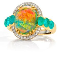 These colors are a KNOCKOUT together! Janet Vitkavage 18k gold Opal ring, surrounded by diamonds and Paraiba Tourmalines.