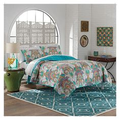 High fashion design meets imaginative and spontaneous style with the Vue Daria Reversible 3-Piece Quilt Set. This contemporary quilt features vibrant, watercolor dots that create a playful allover damask. Reverse features an abstract, tie-dye motif.  Queen quilt measures 92x96 and includes two 20x26 shams, and King quilt measures 110x96 and includes two 20x36 shams. 100% cotton. Easy care, machine washable.