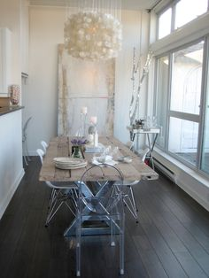 Love all of the textures and finishes in this dinning room ~ the lucite against the rustic dining table is so cool and unexpected...