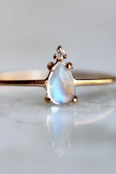 Hints of purple, blue, and pink shine in this pear shaped moonstone ring.