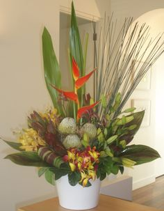 Native Australian flowers and tropical flowers - stunning arrangement Tropical Floral Arrangements, Tropical Flowers, Fresh Flowers, Flower Arrangements, Australian Flowers, Corporate Flowers, Food Buffet, Tropical Christmas, Funeral Arrangements